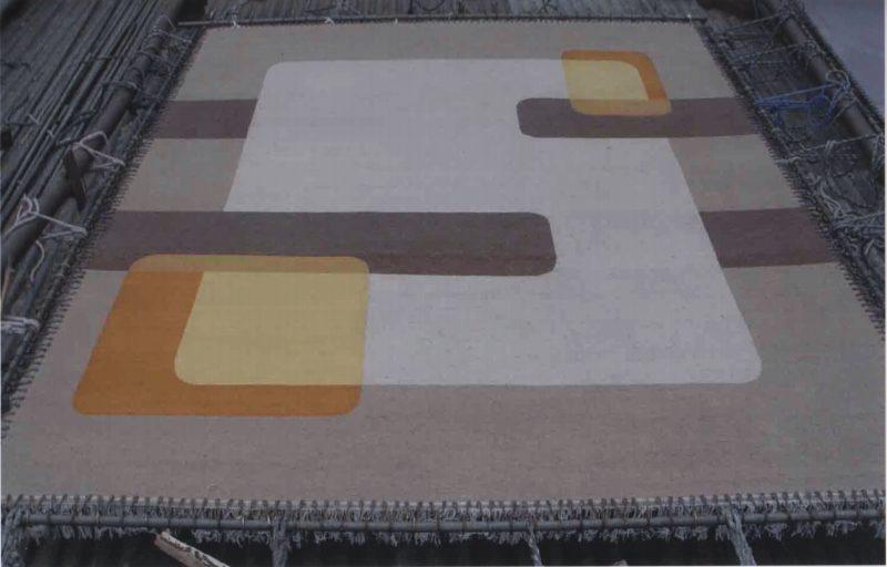 Finished WINDOWS carpet on loom